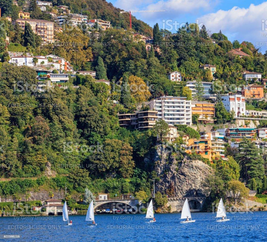Sailboats on Lake Lugano in Switzerland stock photo