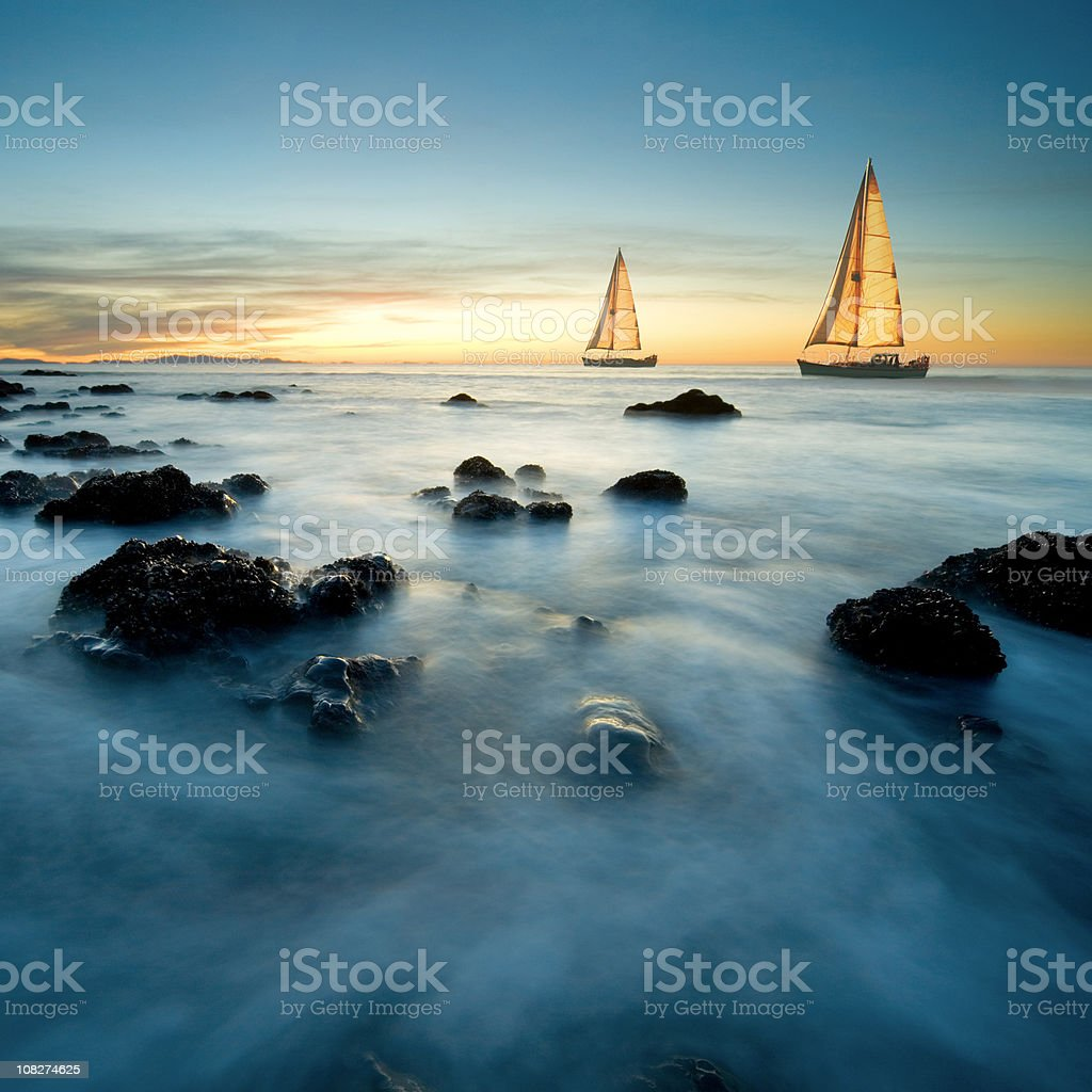 Sailboats on Sea at Dusk stock photo