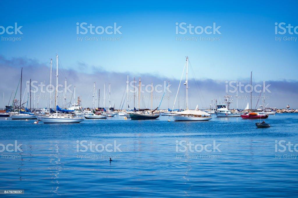 sailboats on the horizon stock photo