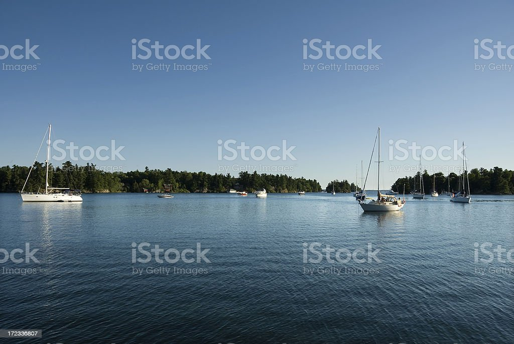 Sailboats on the St. Lawrence River in Ontario, Canada royalty-free stock photo