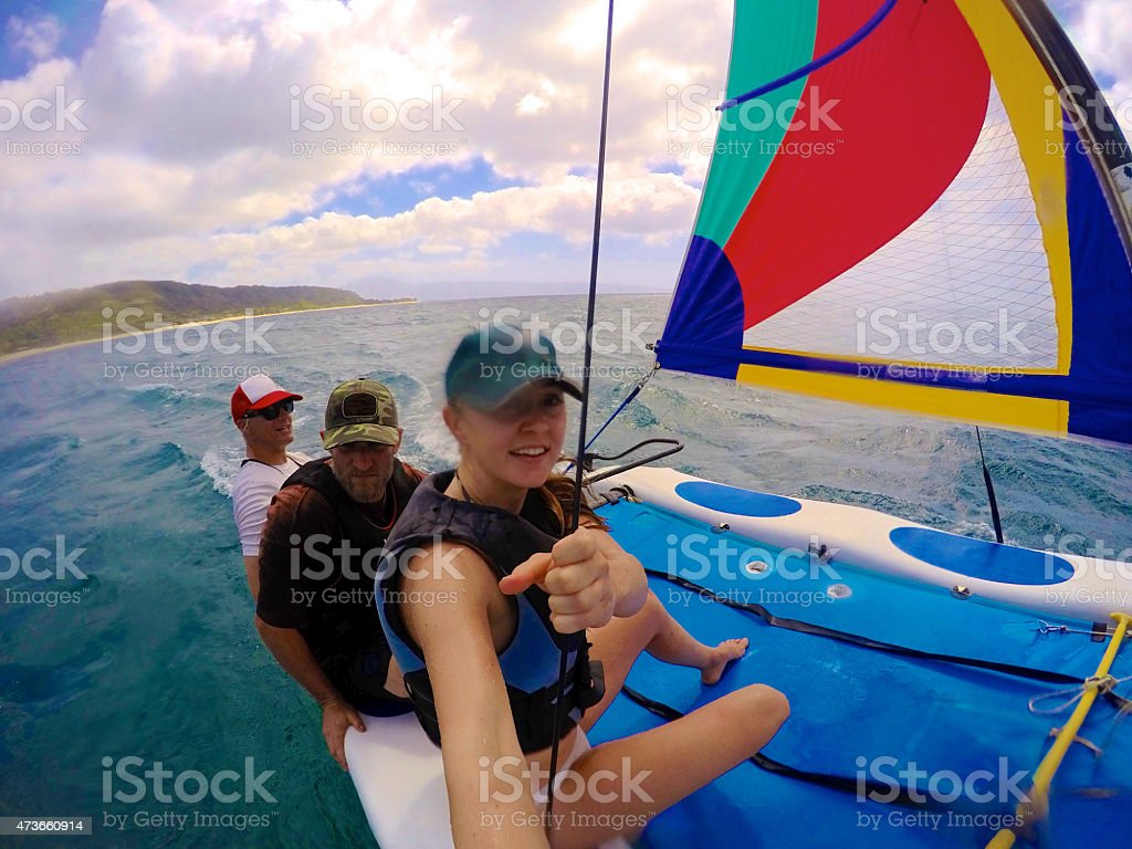 Sailing a Hobie Cat with Friends in Hawaii stock photo