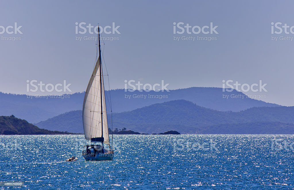 Sailing a yacht in the Whitsundays stock photo