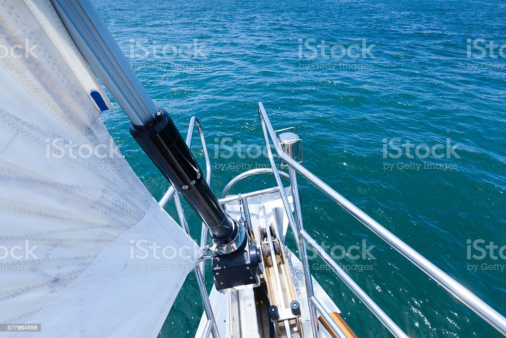 Sailing across clear blue water stock photo