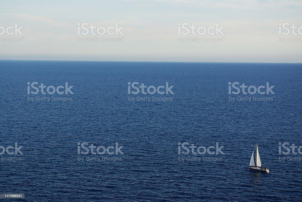 Sailing alone stock photo