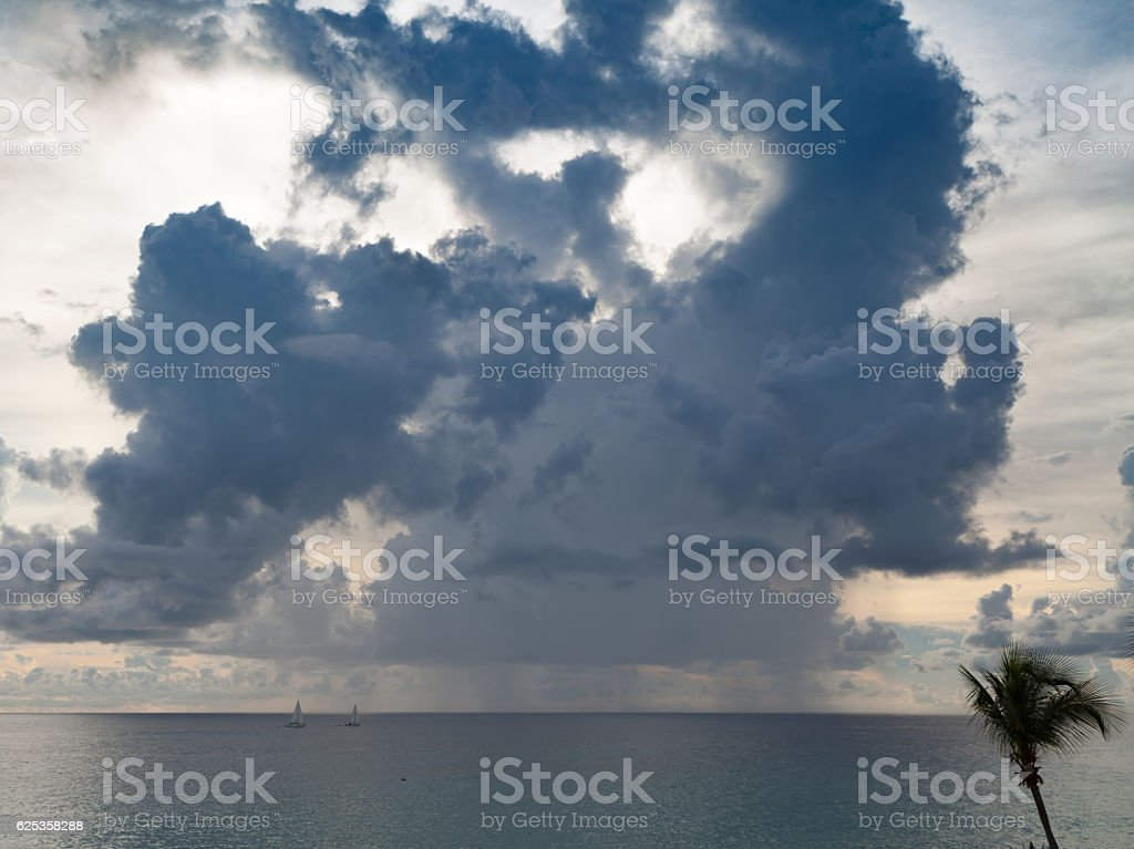 Sailing amongst the dark clouds and rain showers stock photo