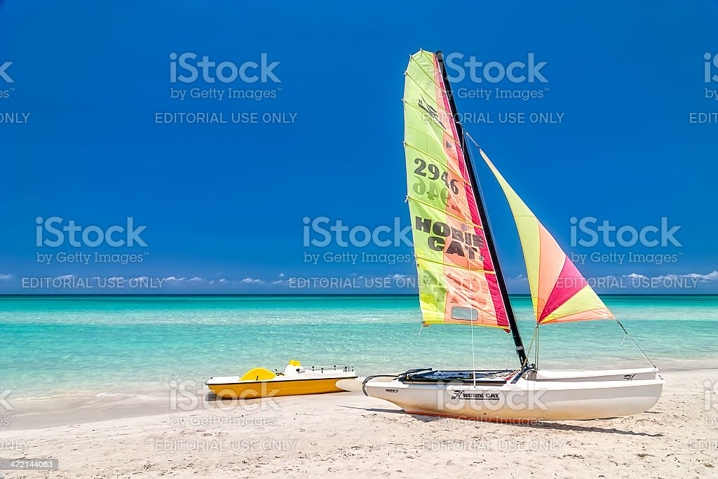 Sailing and pedal boats stand under bright sun stock photo