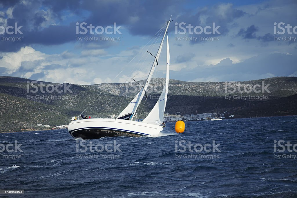 Sailing and stormy weather royalty-free stock photo