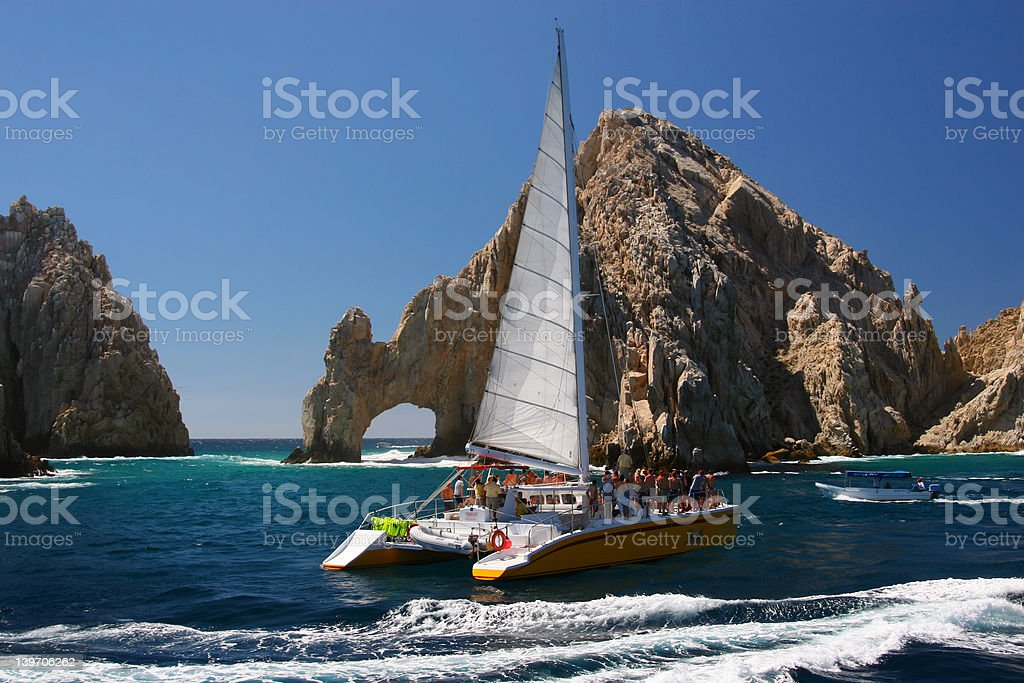 Sailing at Cabo San Lucas Arch stock photo