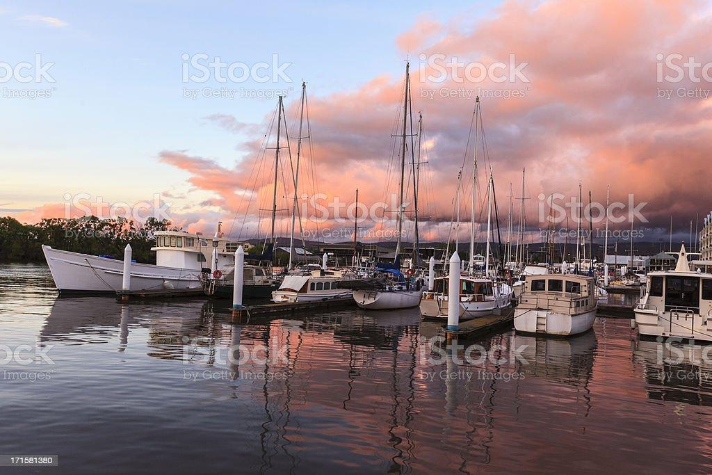 Sailing at dusk stock photo