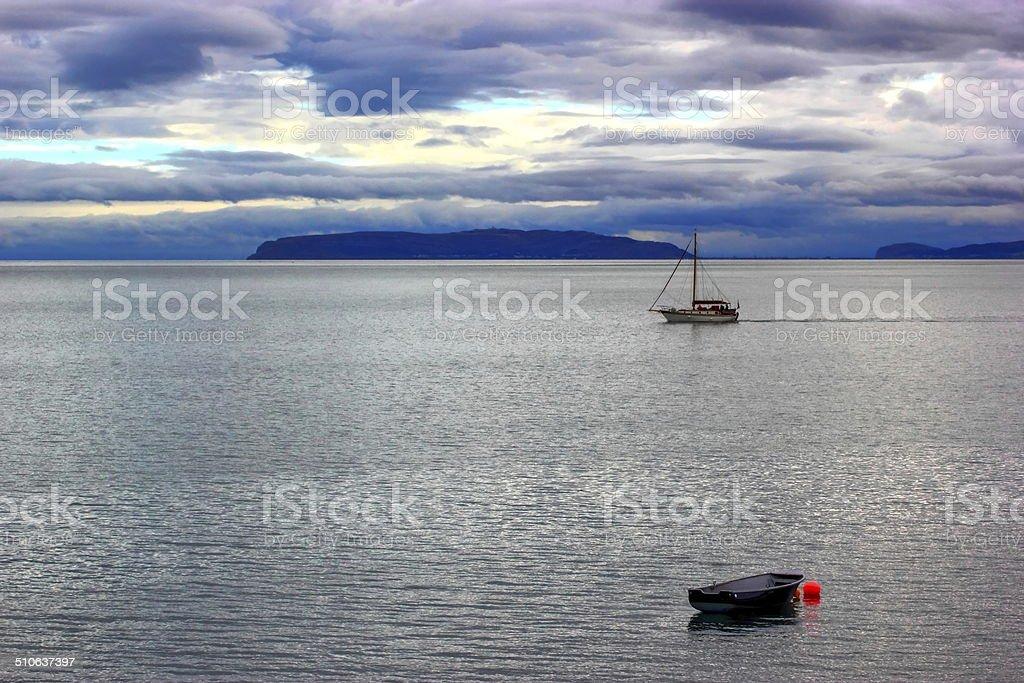 sailing at dusk. stock photo