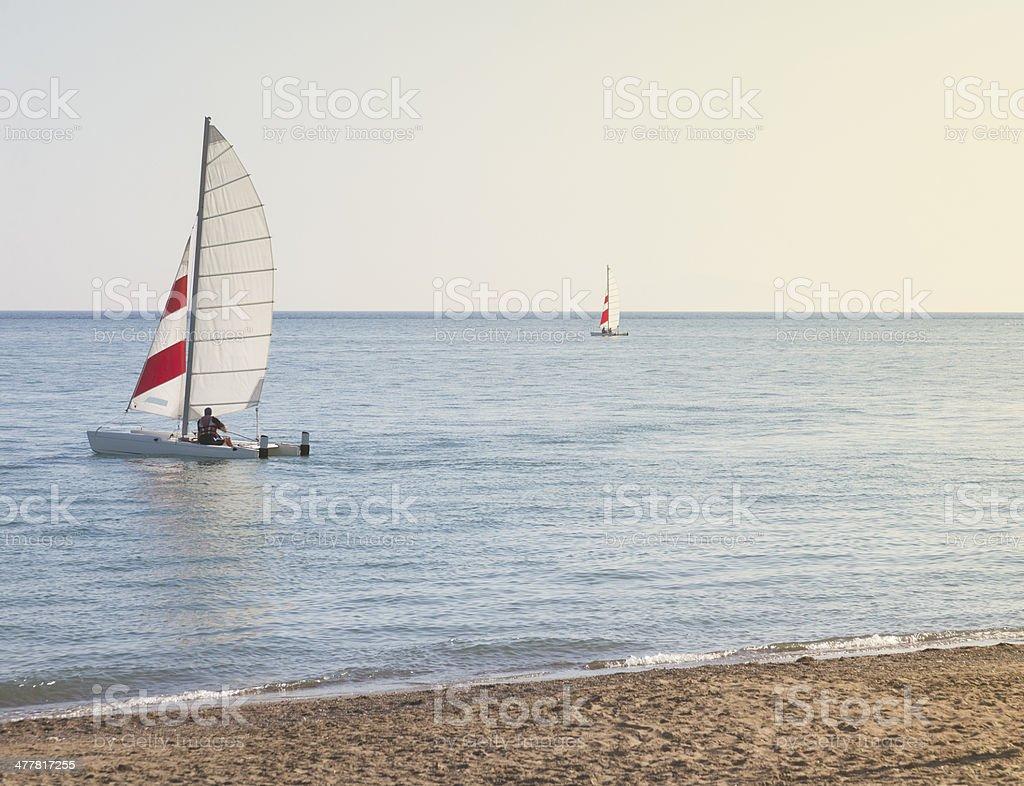 Sailing at sunset royalty-free stock photo
