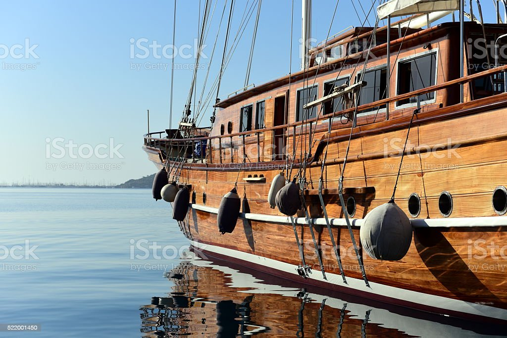 sailing away - gulet - wooden yacht and the horizon stock photo