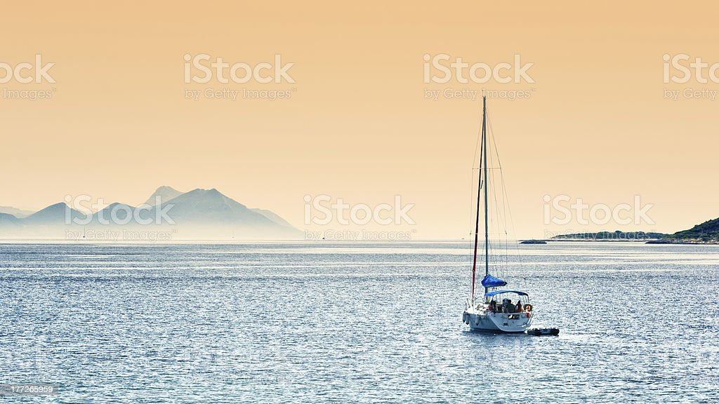 Sailing before sunset royalty-free stock photo