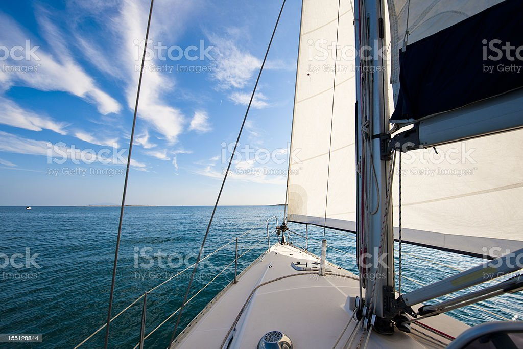 Sailing boat against the blue sky royalty-free stock photo