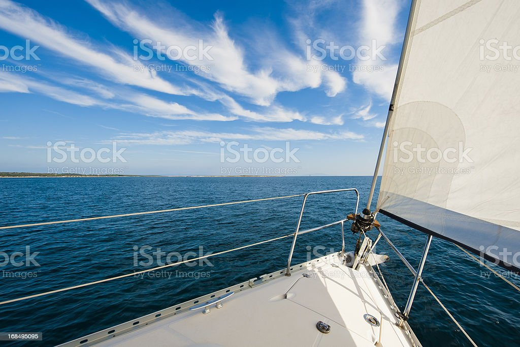 Sailing boat against the blue sky stock photo