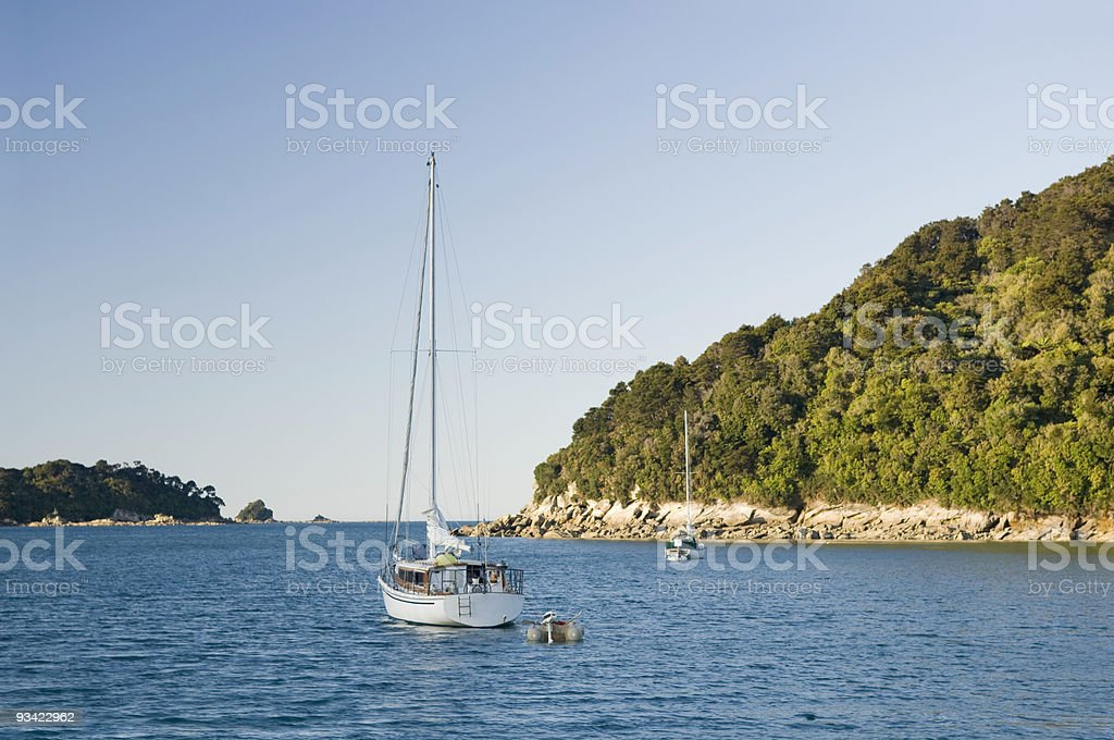 Sailing Boat anchoring in a quiet Bay royalty-free stock photo
