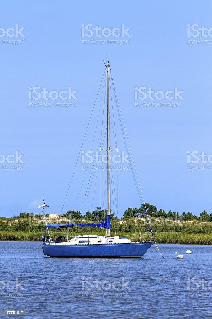 Sailing boat anchoring near beach coastline royalty-free stock photo
