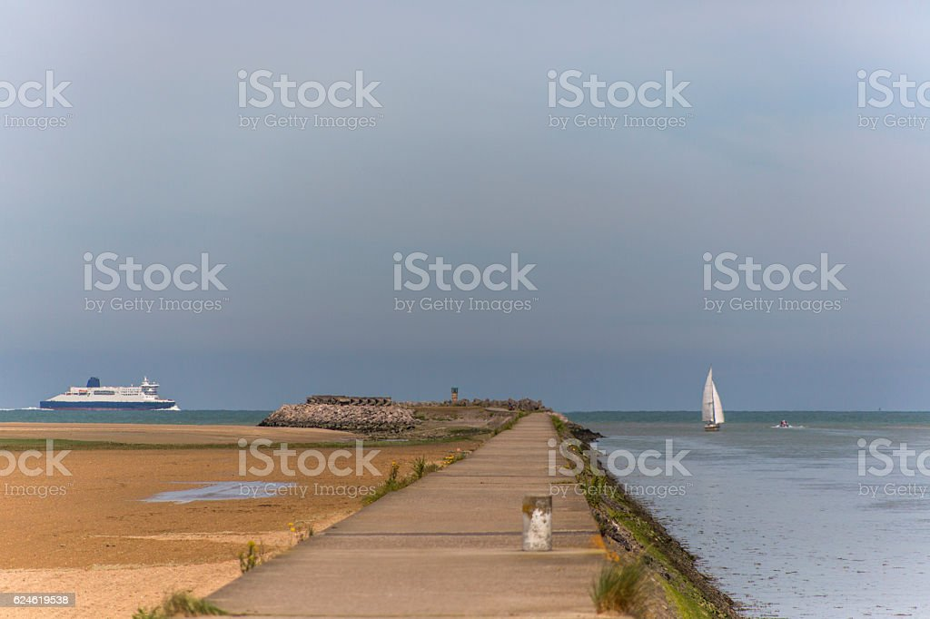 Sailing boat and ferry  travelling at normandy coast  calais france stock photo