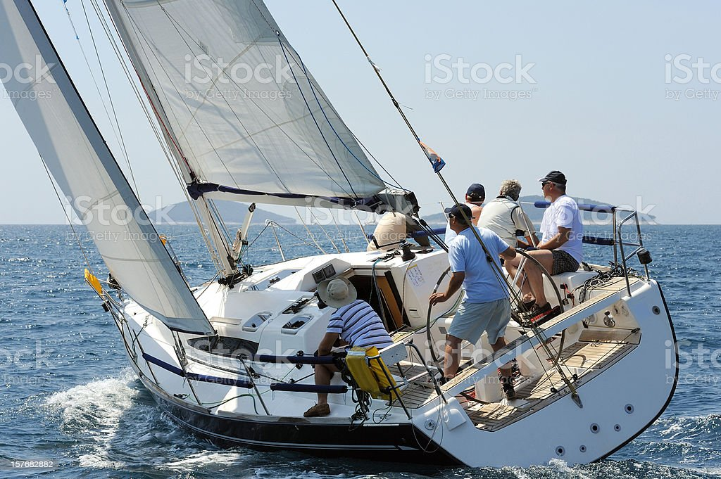 Sailing boat and the crew stock photo