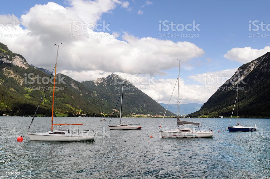 sailing boat at Achsee lake near Innsbruck (Austrian) stock photo