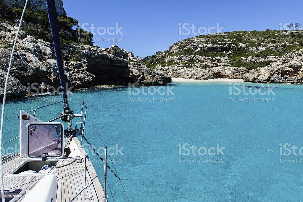 Sailing boat at anchor. Paradise wild bay. Cala Marmolis. stock photo