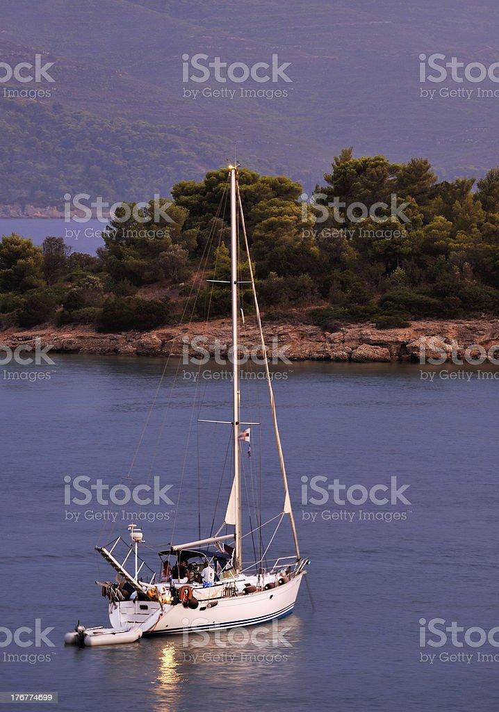 Sailing boat at dusk royalty-free stock photo