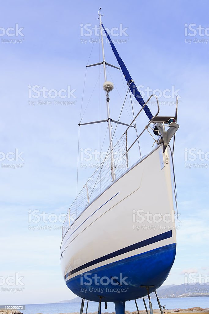 Sailing boat beached for annual check royalty-free stock photo