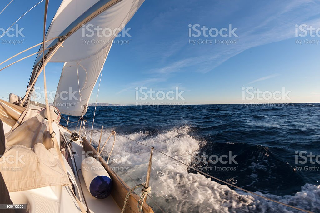 Sailing boat crop in the sea stock photo