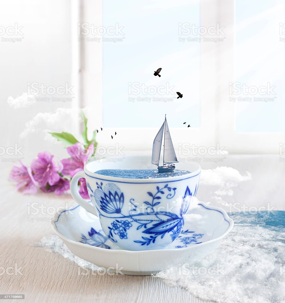 Sailing Boat in a cup of tea with birds royalty-free stock photo