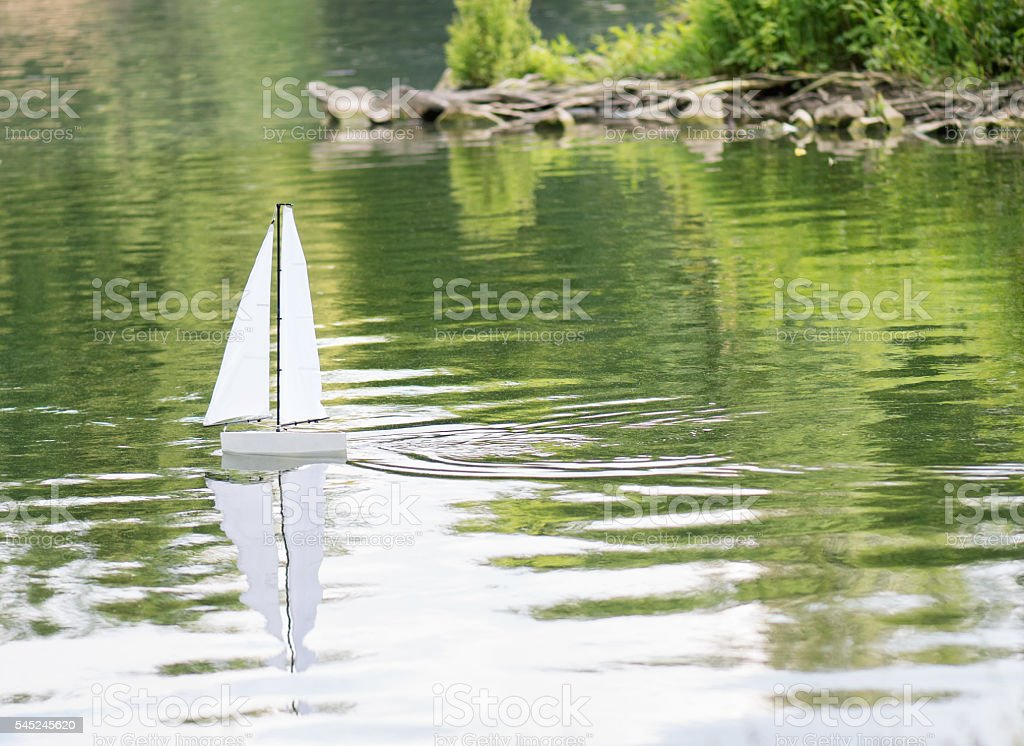 Sailing boat in a pond stock photo