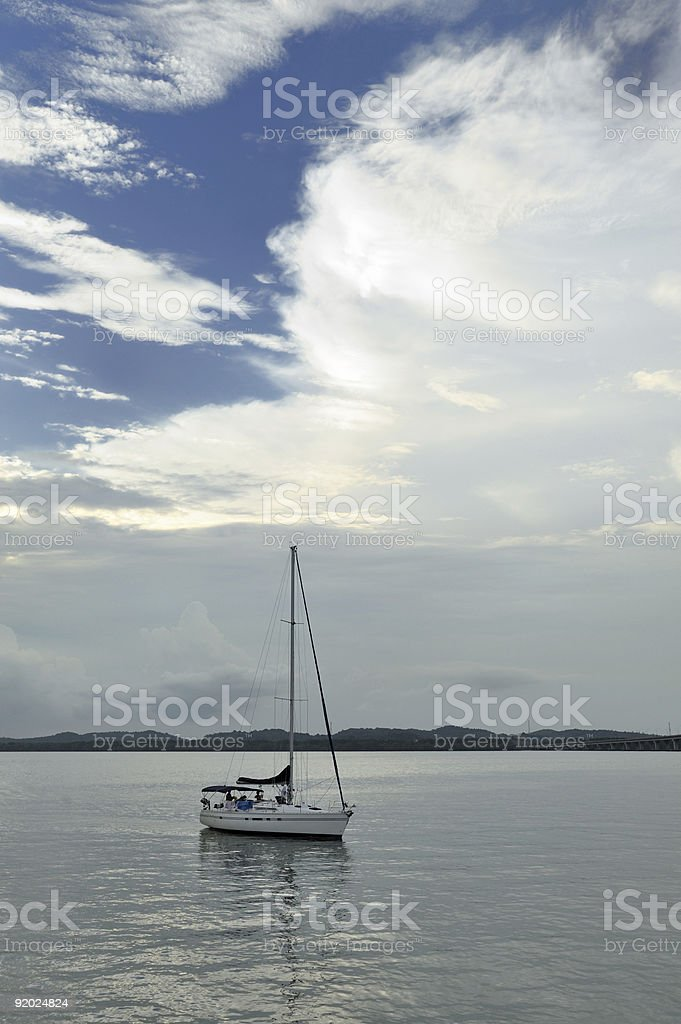 Sailing boat in Singapore harbor royalty-free stock photo
