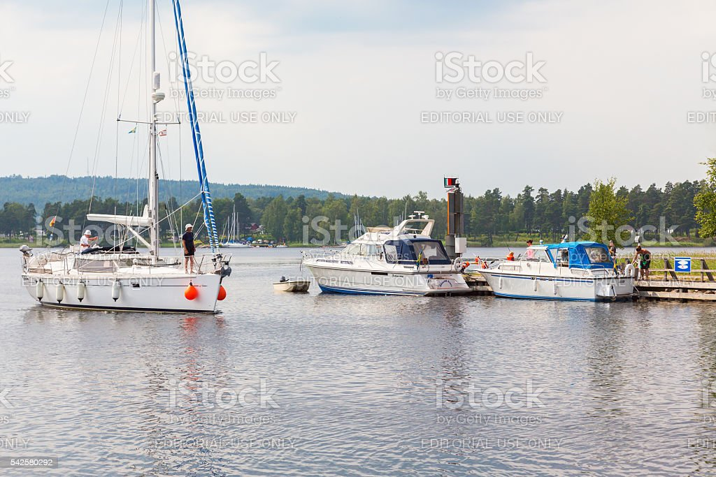 Sailing boat in the channel stock photo