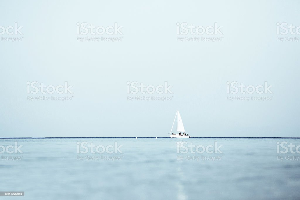 Sailing boat in the lake stock photo