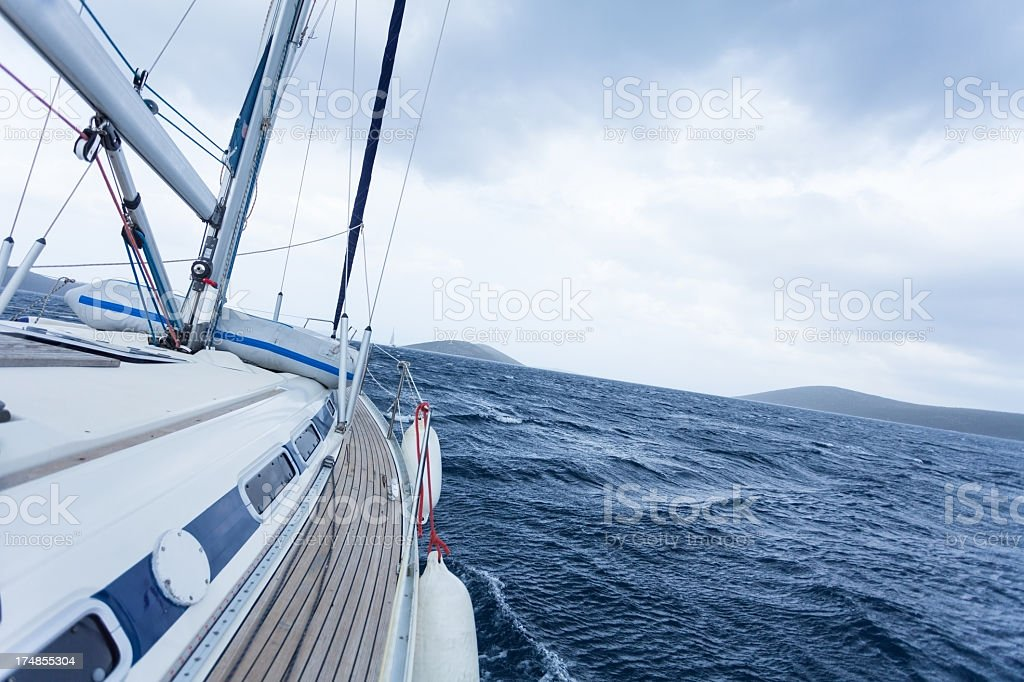 Sailing boat in the sea, blue sky royalty-free stock photo
