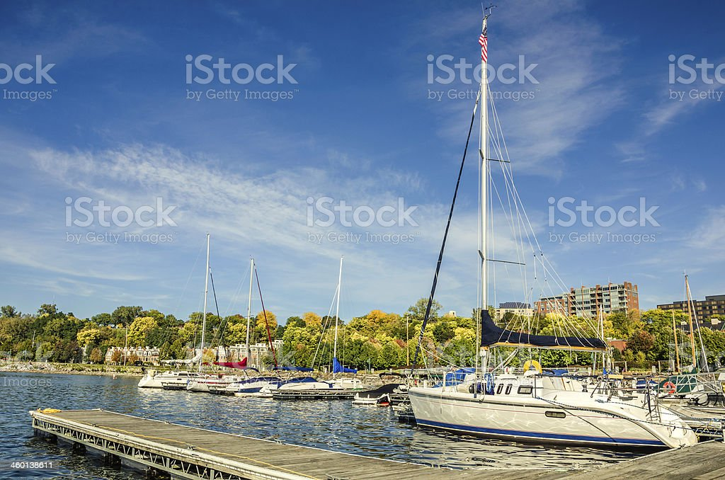 Sailing Boat Moored to a Jetty at Sunset stock photo