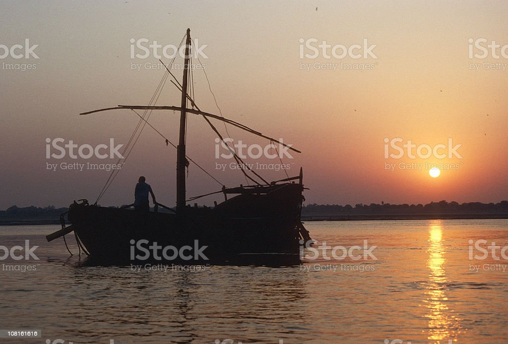 Sailing boat on Ganges River at sunrise royalty-free stock photo