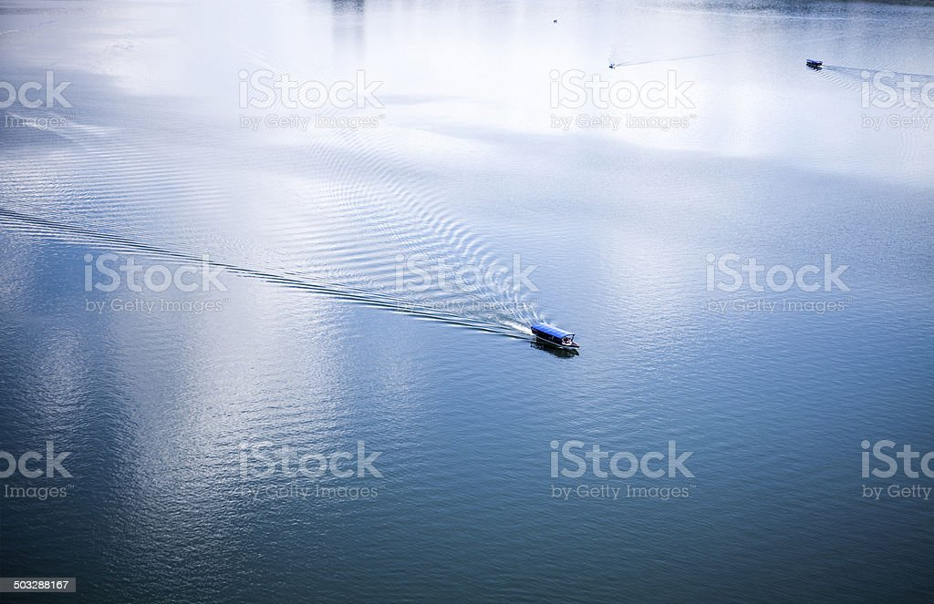 Sailing boat on lake stock photo