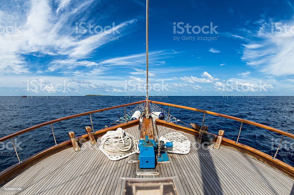sailing boat on the ocean stock photo