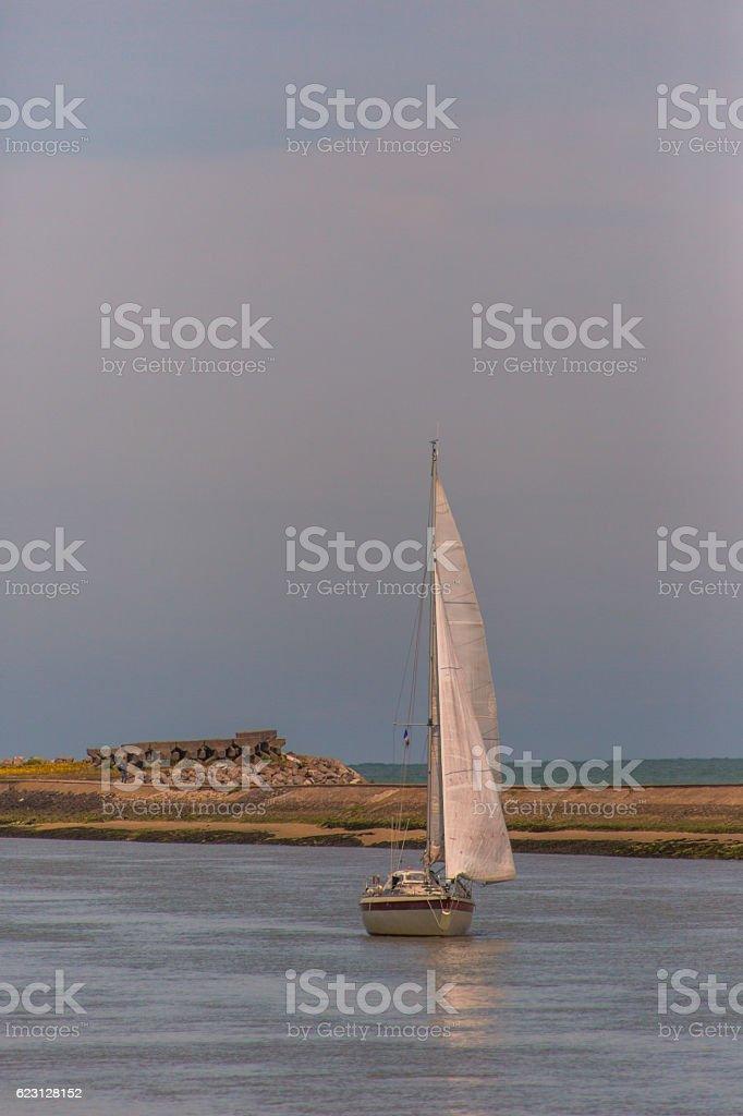 Sailing boat travelling at normandy coast near calais france stock photo
