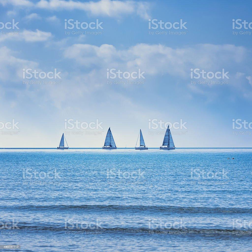 Sailing boat yacht regatta race on sea or ocean water stock photo