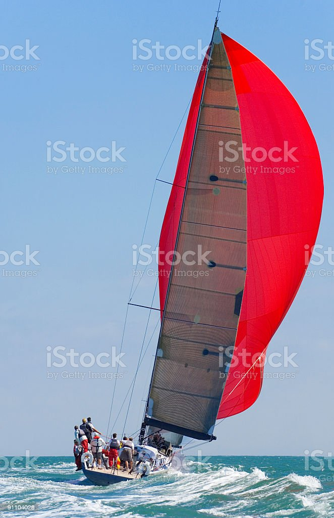 Sailing Boat Yacht With Red Sail Racing At Full Power stock photo