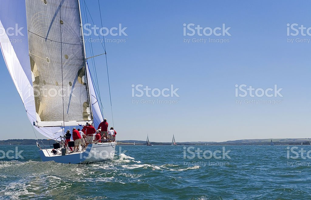 Sailing Boat Yacht With White Sails on Blue Sea stock photo