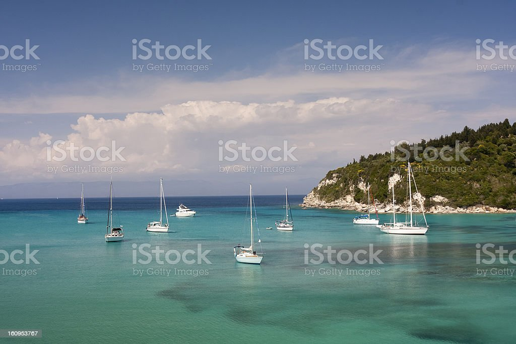 Sailing boats anchored in Lakka harbour stock photo