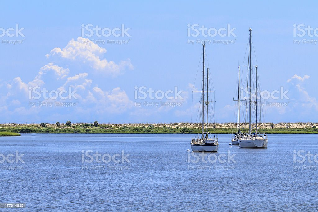 Sailing boats anchoring near beach coastline royalty-free stock photo