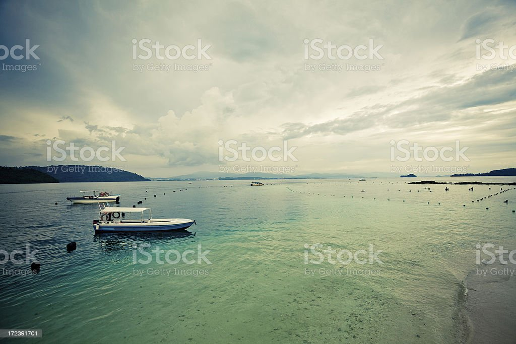 Sailing Boats and Ocean with Stormy Sky royalty-free stock photo