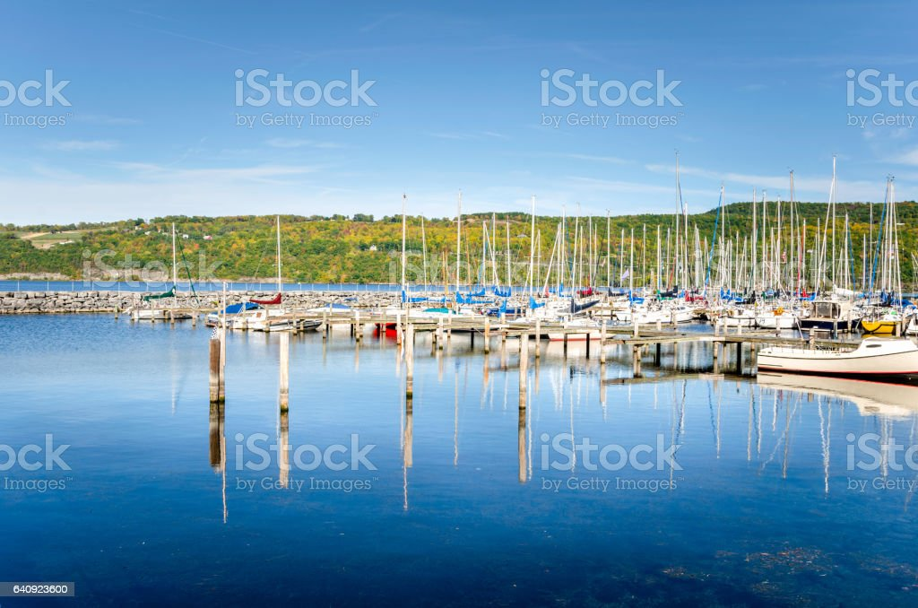 Sailing Boats in a Marina and Reflection in Water stock photo