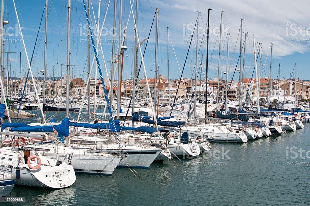 Sailing boats in Cambrils Harbour, Tarragona, Spain. stock photo