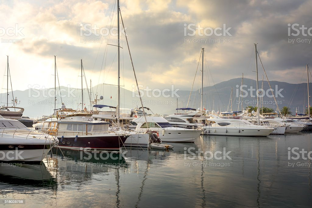 Sailing boats in marina at sunset. Tivat. Montenegro stock photo
