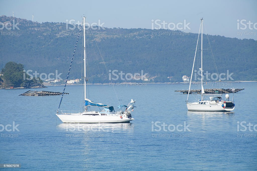 Sailing boats mooring in Galicia, Spain. stock photo