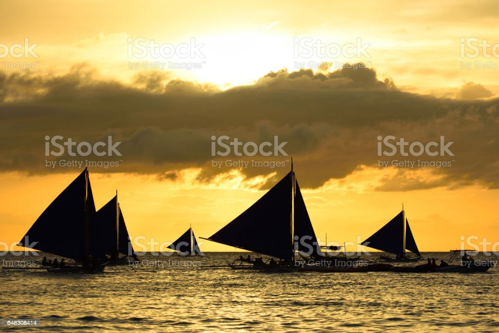 sailing boats with sunset stock photo